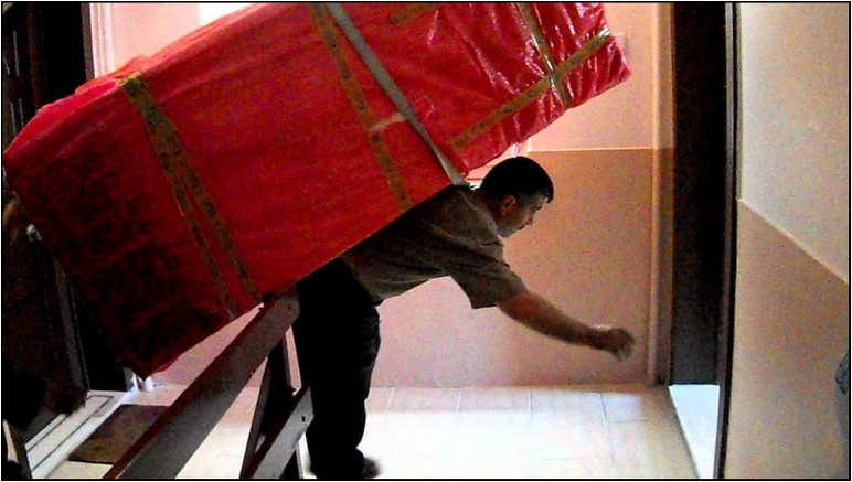 Moving A Refrigerator Down Stairs